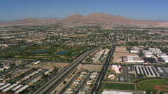 Flying over outlying Las Vegas above I-15 and Las Vegas Boulevard. Shot in 2008. Arkistovideo