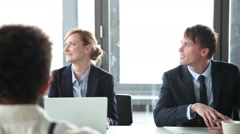 Business people sitting at table in conference room and listening presentation Stock Footage
