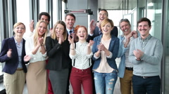 Portrait of business and advertising team, laughing and clapping - stock footage