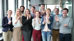 Portrait of happy business people, laughing and clapping - stock footage