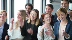 Close up of happy business people, laughing and clapping - stock footage