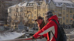 Two Men Are Talking Steam Comes Out of Mouth Standing on a Bridge Winter Stock Footage