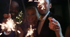 Sexy group of friends at glamorous party lighting sparklers Arkistovideo