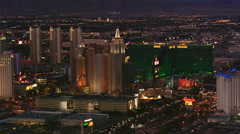 Flying past The Strip near Tropicana Avenue in Las Vegas at nightfall. Shot in Stock Footage