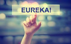 Eureka concept with hand pressing a button Stock Photos