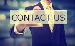 Business man holding Contact Us Stock Photos