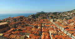 Aerial view of the red roofs of Old Town of Dubrovnik Stock Footage