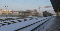 Freight Electric Train Passing by Empty Station Leaving the Station Green Train Stock Footage