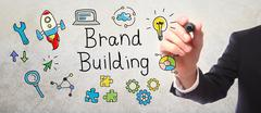 Businessman drawing Brand Building concept - stock illustration