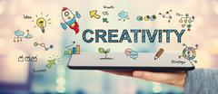 Creativity concept with man holding a tablet Stock Illustration