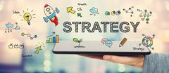 Strategy concept with man holding a tablet Stock Illustration