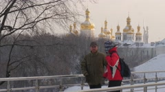Two Men Friends Father And Son Are Walking Pedestrian Bridge in Park and Stock Footage