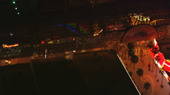 Close flight over the Four Queens on Fremont Street in Las Vegas at night. Shot - stock footage