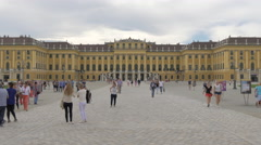 Young women taking pictures in front of Schönbrunn Palace, Vienna Stock Footage