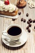 Assorted bakery desserts with coffee - stock photo