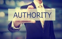 Business man holding Authority concept - stock photo
