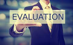 Business man holding Evaluation - stock photo