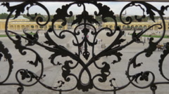 Courtyard of Schönbrunn Palace seen through a wrought iron balustrade, Vienna - stock footage