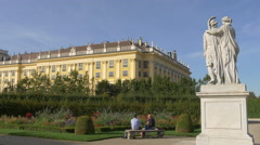 Sitting on a bench in the imperial park of Schönbrunn Palace, Vienna Stock Footage