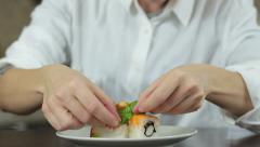 Sushi master preparing sushi in Japanese restaurant, close up HD Stock Footage