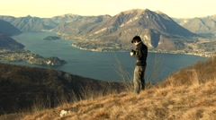 Boy makes bird watching in the mountains Stock Footage