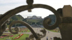 Imperial garden of Schönbrunn seen through a wrought iron balustrade, Vienna - stock footage