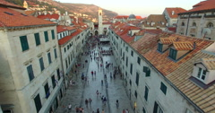 Aerial view of tourists walking on Stradun at sunset Stock Footage