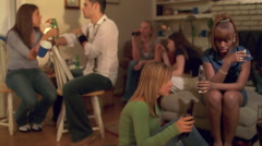 Teenagers drinking at an unsupervised house party Stock Footage