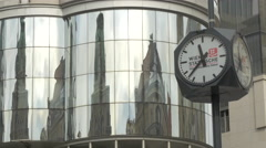 Four dial street clock next to the Haas House building in Vienna Stock Footage