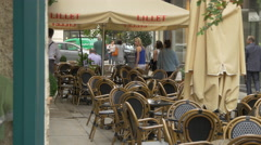 Outdoor restaurant on a narrow street in Vienna Stock Footage
