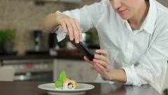Woman with smartphone taking picture of sushi at restaurant HD Stock Footage