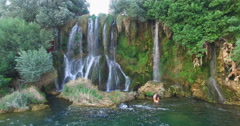 Couple relaxing at Roski slap waterfalls on Krka river Stock Footage