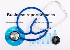Stethoscope on the chart statistics business sales report Stock Photos