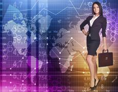 Business woman standing with a briefcase on background economic graphics Stock Photos