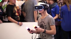 Young boy playing with virtual reality glasses in Game center. Stock Footage