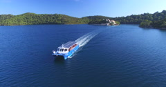 Aerial view of catamaran sailing off St. Mary island on island of Mjlet, Croatia - stock footage
