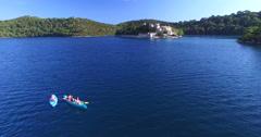 Aerial view of people kayaking on the island of Mjlet, Croatia - stock footage