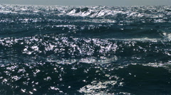 Ultra-slow motion glittering waves rolling from the horizon Stock Footage