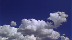 Bright white time-lapse clouds in blue sky - stock footage