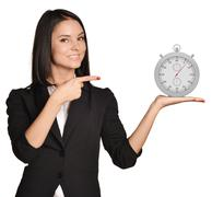 Office girl standing on white background and holding stopwatch Stock Photos