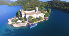 Aerial view of catamaran arriving at St. Mary island on Mljet Island, Croatia Stock Footage