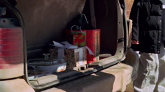 Christmas gifts and food dishes being removed from back of mini-van Stock Footage