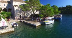 Tourists at St. Mary island on island of Mjlet, Croatia Stock Footage