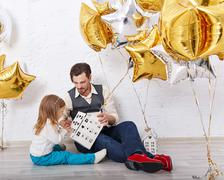 Father plays with daughter. Family celebration. - stock photo