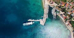 Aerial view of ferry leaving port at Olib Island, Croatia Stock Footage