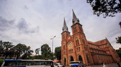 Age-old Catholic Church near Street Traffic Clouds Motion - stock footage