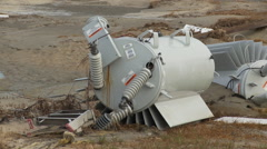 Close view of toppled electrical transformer in aftermath of hurricane Stock Footage