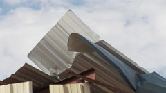 Close view of bent and torn sheet metal siding after a hurricane - stock footage