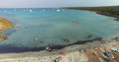 Tourists enjoying on beautiful Slatinica beach at Olib Island, Croatia Stock Footage