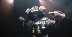 Japanese samurai in the historical suit threatens with a sword , posing for the Stock Footage